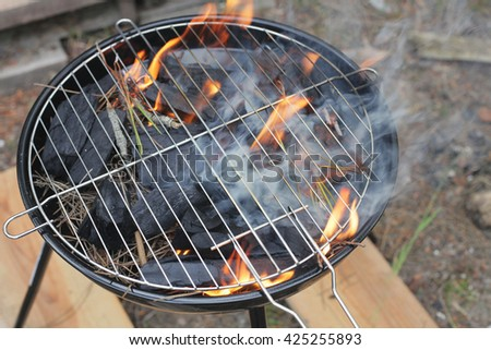 Stainless steel barbecue grill. Fire embers with the ashes.Preparing for bbq - stock photo
