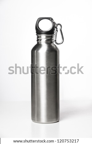 Stainless steel bottle on white background with clip. - stock photo
