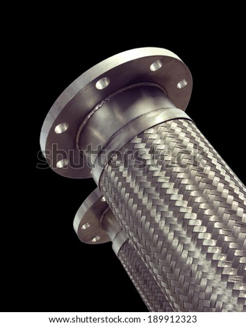 Stainless steel braided corrugated metal hose.Industrial transportation tube. - stock photo