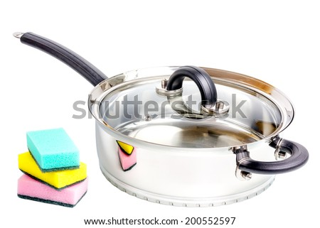 Stainless steel deep stewing pan with sponges isolated on white background - stock photo