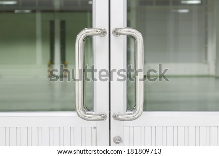 Stainless steel door handle. - stock photo
