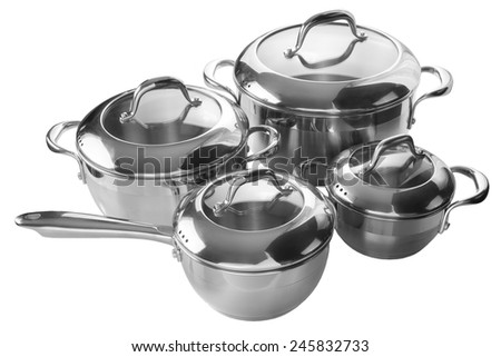 Stainless steel pans and pots isolated on white background - stock photo