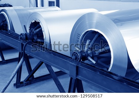 stainless steel plate in a workshop, in a factory - stock photo