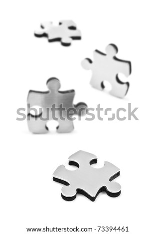 Stainless steel puzzle pieces on white background with space for text - stock photo