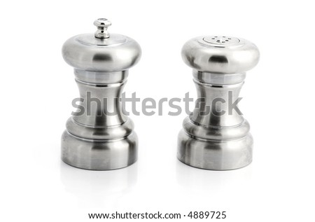 Stainless steel salt and pepper shakers isolated - stock photo