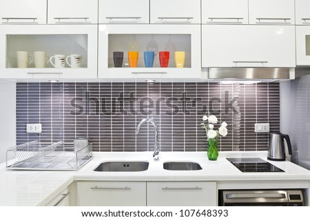 Stainless steel sink on top white granite - stock photo