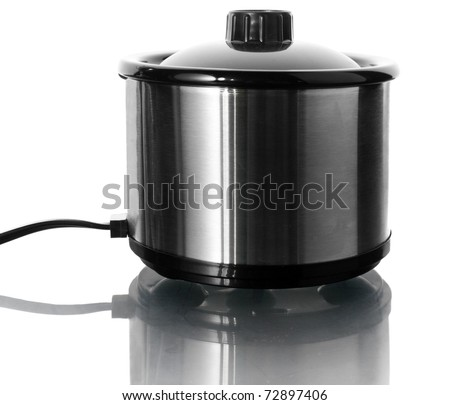 Stainless steel slow cooker on white - stock photo