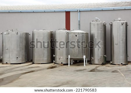 Stainless steel storage tank silos for industry - stock photo