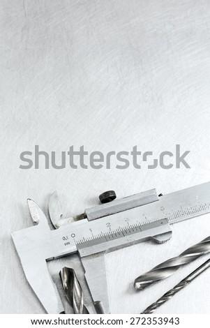 Stainless steel vernier caliper measure diameter of drill bits - stock photo