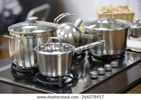 stainless utensils on gas cooker - stock photo