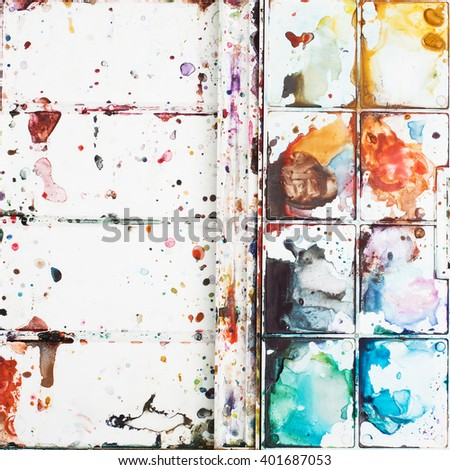 Stains watercolor paints on a palette. It can be used as an original background, space for text. The concept of creativity, drawing education, bright ideas, etc. - stock photo