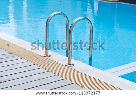 Stair in chrome color at swimming pool - stock photo