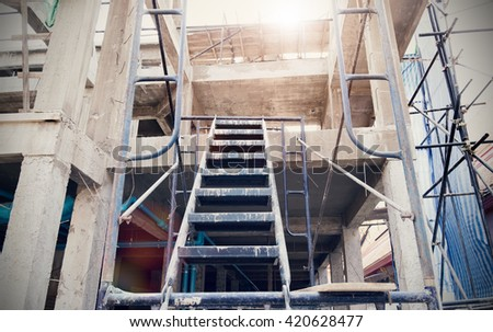 Staircase and cement with steel poles for construction - stock photo