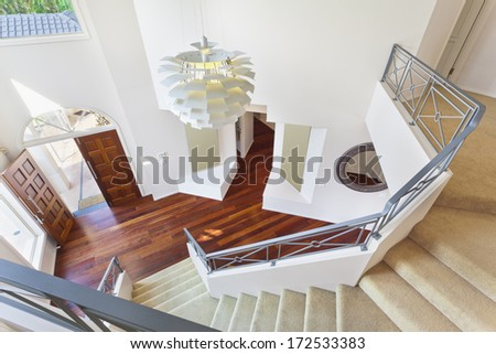 staircase and entrance to modern australian home from above - stock photo