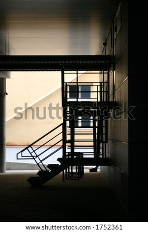 staircase at the end of the corridor - stock photo