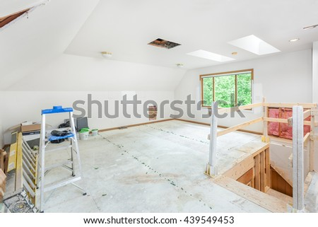 Staircase change roughed in and carpet removed - stock photo