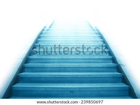 Staircase going up to the white light with isolated background,blue color monotone picture - stock photo