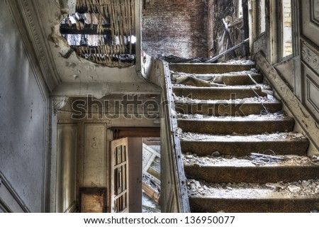 Staircase in abandoned house, hdr photo - stock photo