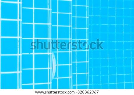 Staircase Tiles on swimming pool ground - stock photo
