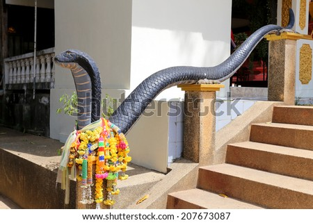 Staircase with cobras - stock photo