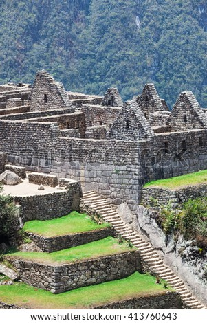 stairs and ancient houses to Machu Picchu - stock photo