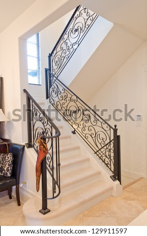 Stairs and handrail leading to the upper, low level. Interior design. - stock photo