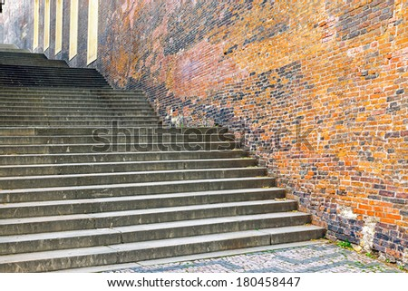 Stairs and old brickwall - stock photo