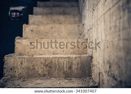 Stairs architecture unfinished at basement. Cement concrete staircase on construction site - stock photo