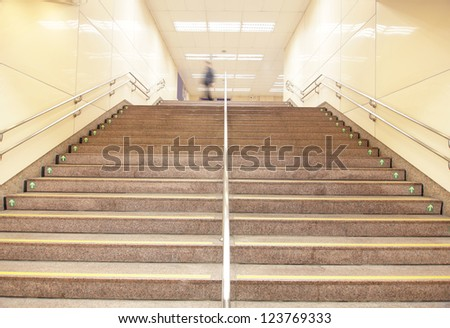 stairs at a metro railway station with motion blur people,  shot in Taipei, Taiwan, asia - stock photo