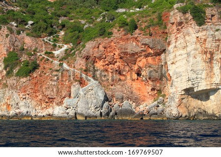 Stairs descending to the coastal line of Adriatic sea - stock photo