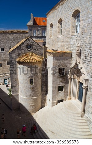 Stairs in front of the gate into the Dominican Church building in Dubrovnik Old Town, Croatia - stock photo