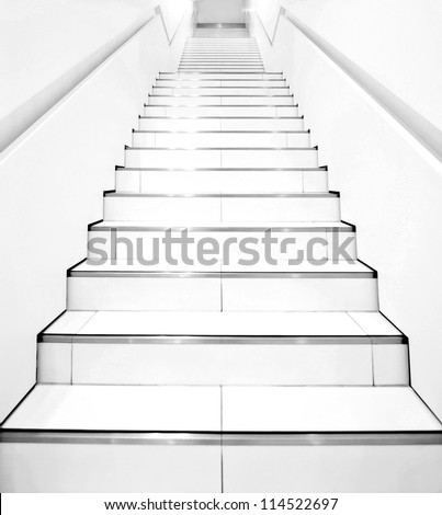 Stairs in modern black and white interior - stock photo