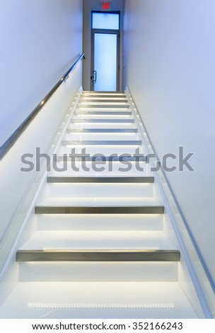 Stairs in modern silver and white interior - stock photo