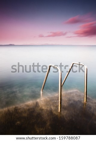 Stairs in Playa Blanca beach in Lanzarote (Spain) - stock photo