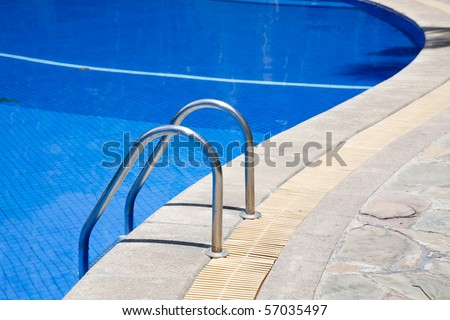 Stairs of a swimming pool - stock photo