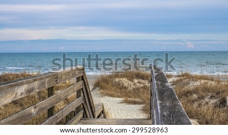 Stairs To The Beach. Wooden stairway leads to the wide sandy beaches of South Carolina's Grand Strand. Myrtle Beach, South Carolina. - stock photo