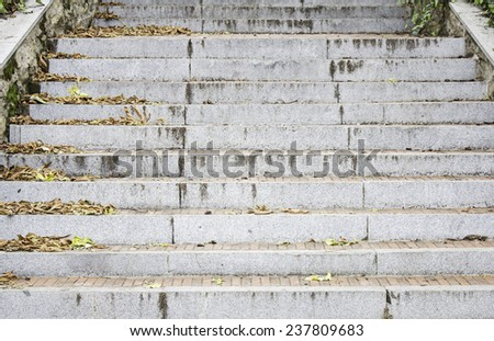 Stairs with autumn leaves in city street - stock photo