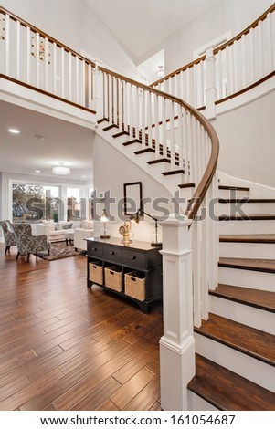 Stairway and Living Room in New Luxury Home - stock photo