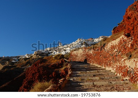 Stairway in volcanic rocks leading to the town of Oia (Santorini island, Greece) - stock photo