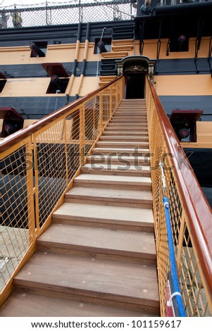 Stairway leading up to the ship with cannons - stock photo