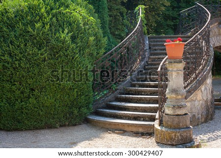 Stairway of a baroque palace with wrought iron banister in a park - stock photo