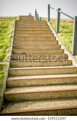 Stairway on sea-dike in Holland - stock photo