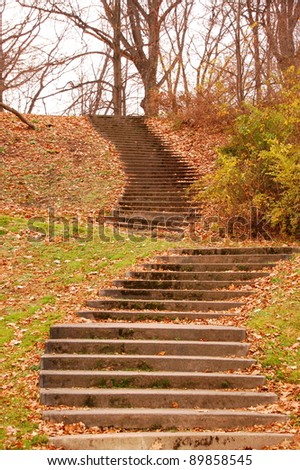 Stairway winds up the autumn hillside - stock photo