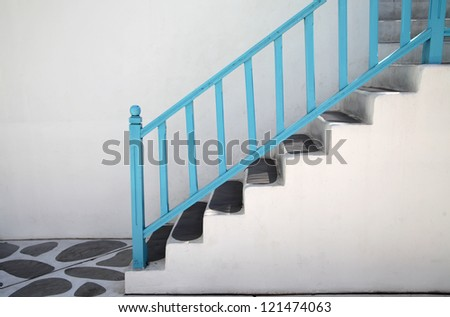 Stairway with blue railing - stock photo