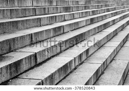Stairway with granite stone steps in perspective, close up. Black and white. - stock photo
