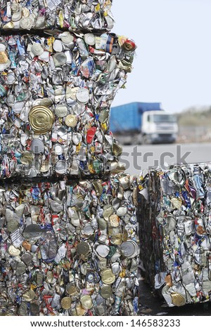 Stakes of crushed tin cans for recycling - stock photo