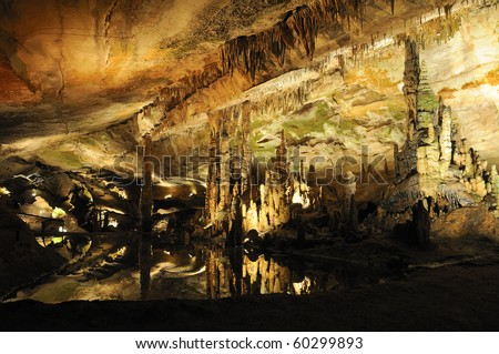 Stalactite Reflections in Cavern Lake - stock photo