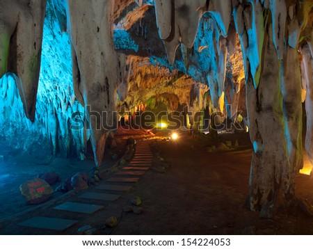 Stalactite wall illuminated with color light in Tham Khao Bin cave, Ratchaburi, Thailand - stock photo