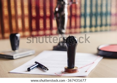 Stamp that is used by a notary public and signed contract.  - stock photo