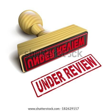 stamp under review with red text over white background - stock photo